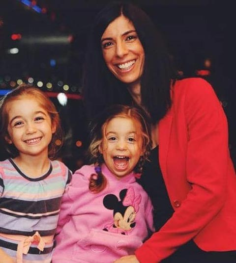 Early photo of Nadine Ismiel-Nash smiling with her two daughters